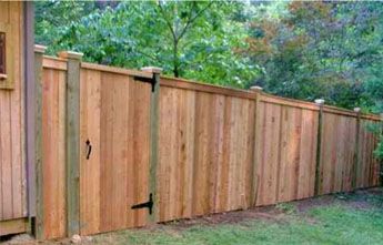 Flat Board Wood Fence with Caps Modern Fence Company Fort Smith Fence Eastern Oklahoma Fencing