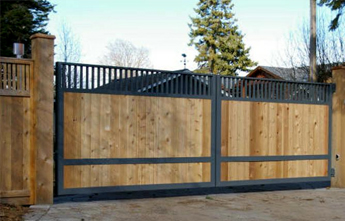 Wood and Iron Sliding Gate Wrought Iron Wood Fence Modern Fence Company Fort Smith Fence Eastern Oklahoma Fencing