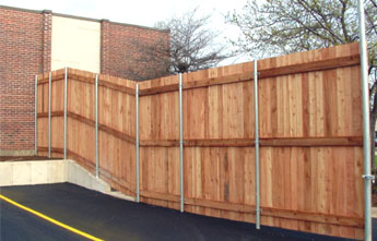 Wood on Steel Fence Wood Fence Commercial Fencing Modern Fence Company Fort Smith Fence Eastern Oklahoma Fencing